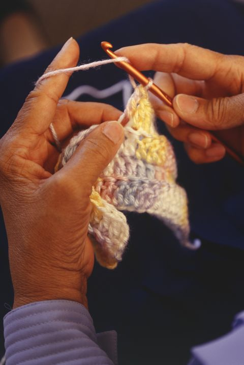woman crocheting, close up of hand