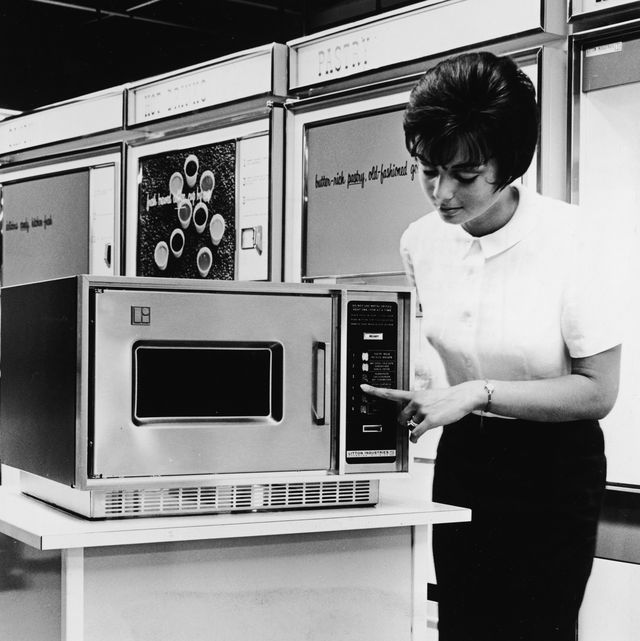 when was the microwave invented, woman demonstrates microwave oven