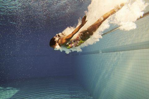 woman diving underwater photo