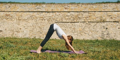 Woman Doing Yoga Down-Dog Pose