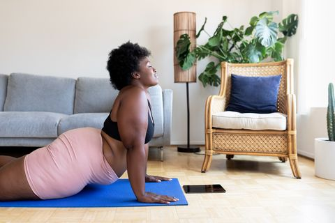 woman doing yoga exercise at home