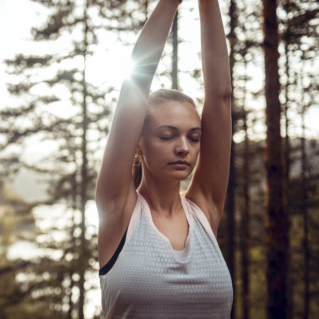 woman doing yoga in the forest