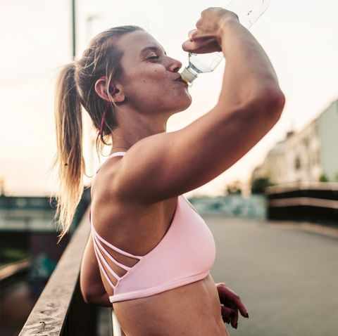 Woman drinking after hard workout.