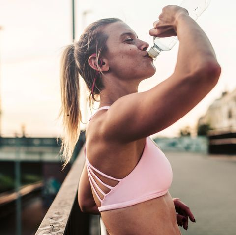woman drinking after hard workout