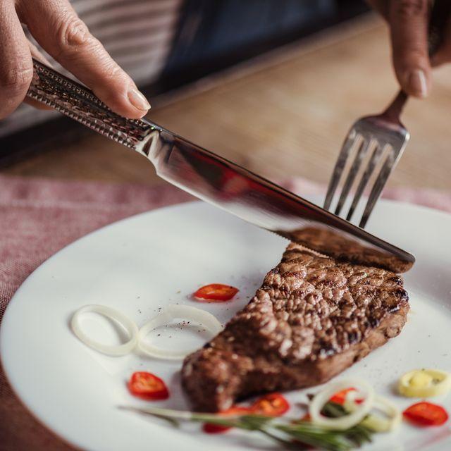 woman eating steak