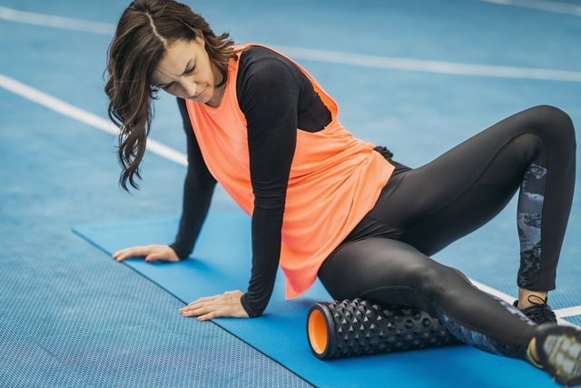 woman exercising at sports court