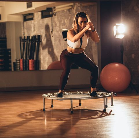 woman exercising on a minitrampoline at the gym