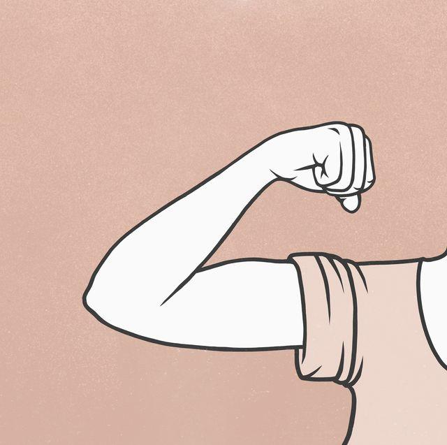 Woman flexing biceps muscle