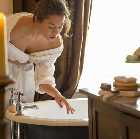 woman getting in the bath