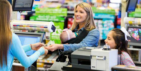 woman handing money to cashier