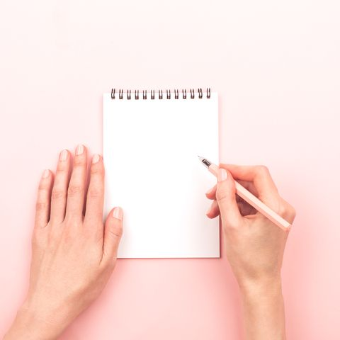Woman hands and a notepad