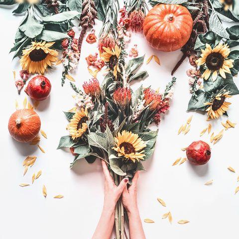 woman hands making autumn flowers bunch