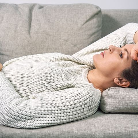 a woman has a stomach ache