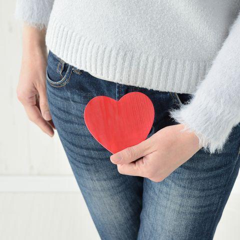 woman having heart object on lower abdomen