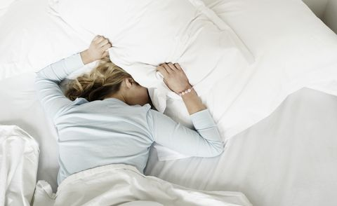 woman having restless nights sleep