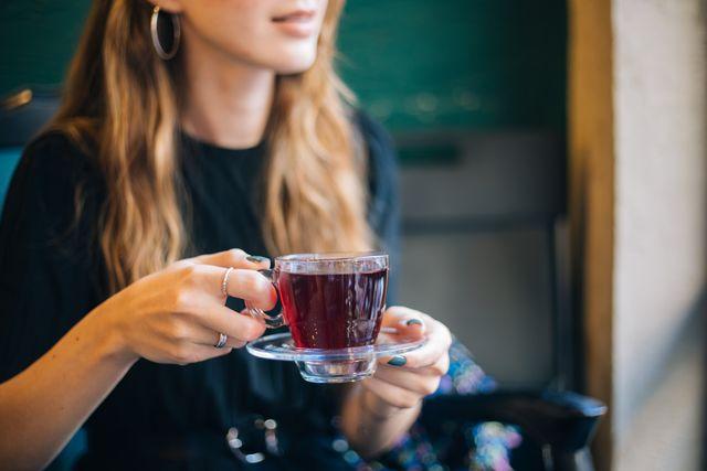 woman having winter tea at coffee