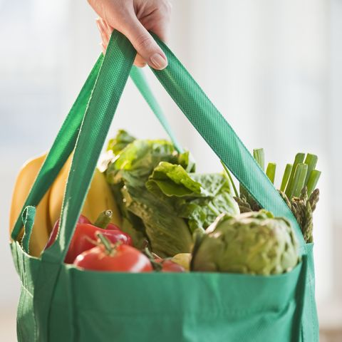Woman holding grocery bag, close-up
