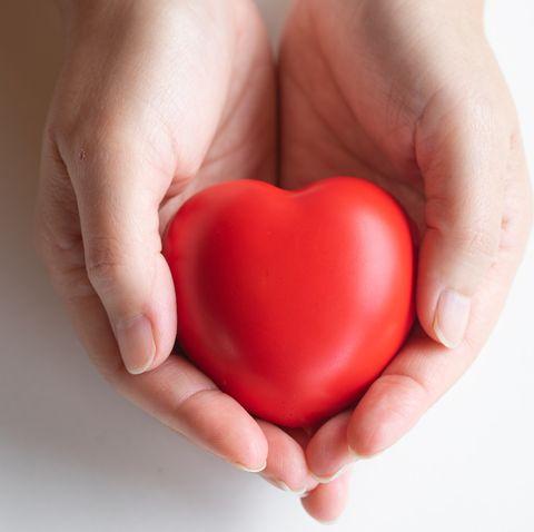 woman holding heart,heart disease