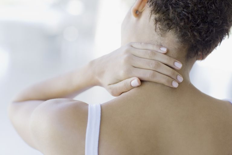 woman holding neck neck pain