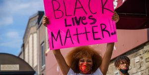 https://hips.hearstapps.com/hmg-prod.s3.amazonaws.com/images/woman-holds-a-black-lives-matter-placard-while-protesting-news-photo-1590592097.jpg?crop=1.00xw:0.755xh;0,0.130xh&resize=300:*
