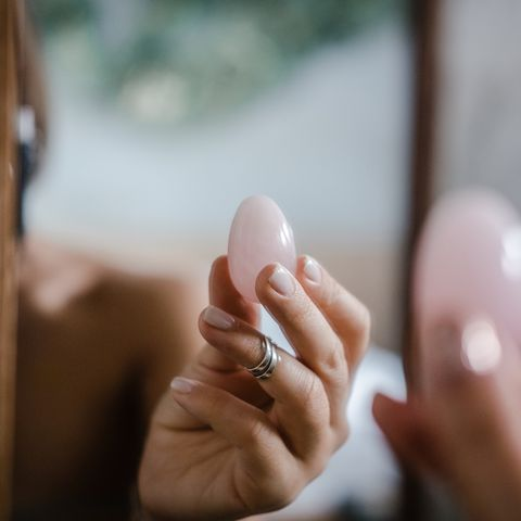 woman holds yoni egg in hand