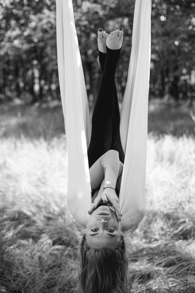 woman in aerial yoga hammock