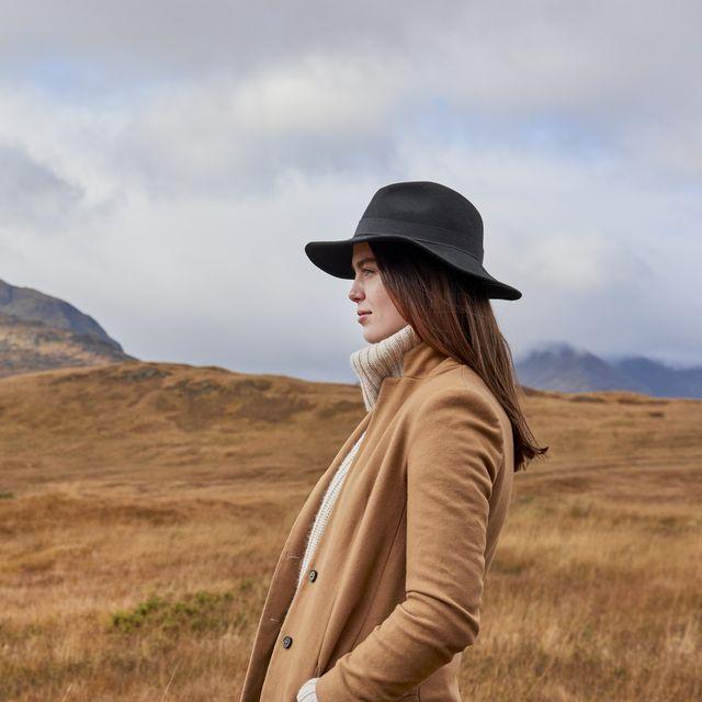 Woman in autumnal landscape