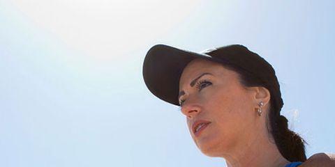 Woman Wearing Running Cap