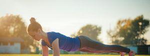 Woman in Chaturanga Dandasana Yoga pose - plank position