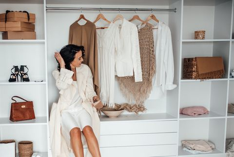 woman in white dress against wardrobe at home