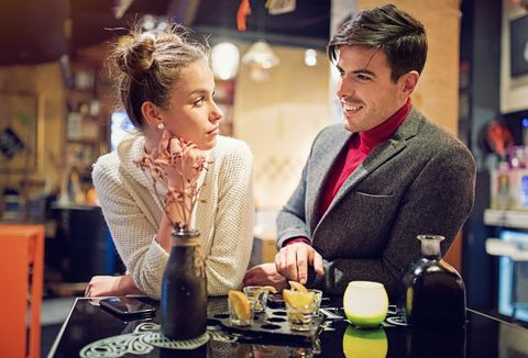 Woman is displeased from her partner at first date in the bar