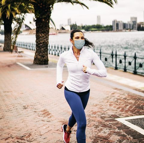 woman jogging wearing healthcare mask for protection how does runnign with mask affect performance