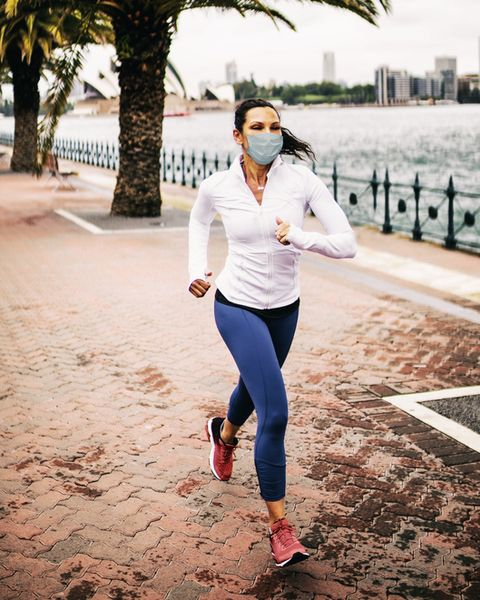 woman jogging wearing healthcare mask for protection