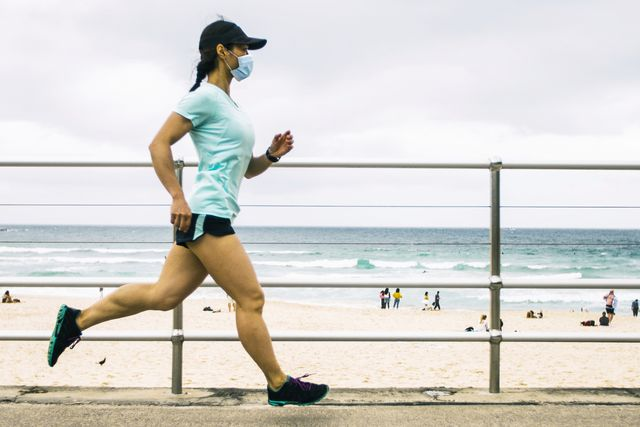 woman jogging wearing healthcare mask