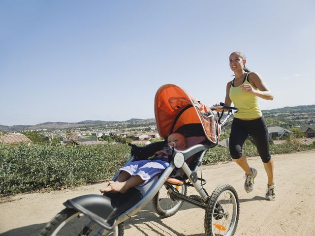 woman jogging with stroller