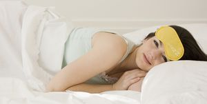 Woman laying in bed with eye mask