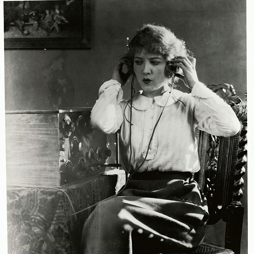 Woman Listening to a Radio