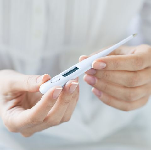 Woman looking at thermometer