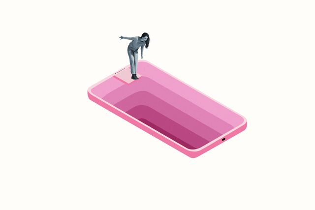 woman looking down deep hole in large pink smart phone