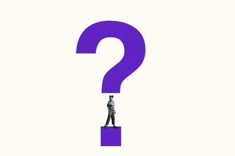 woman looking over shoulder under question mark