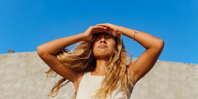 woman looking to the sun