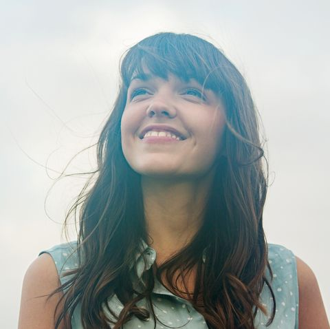 woman looking up, smiling