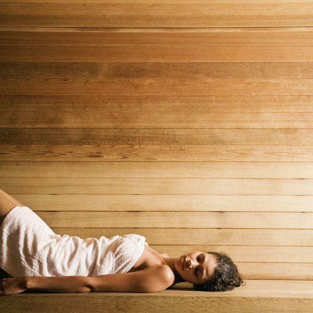 woman lying in sauna
