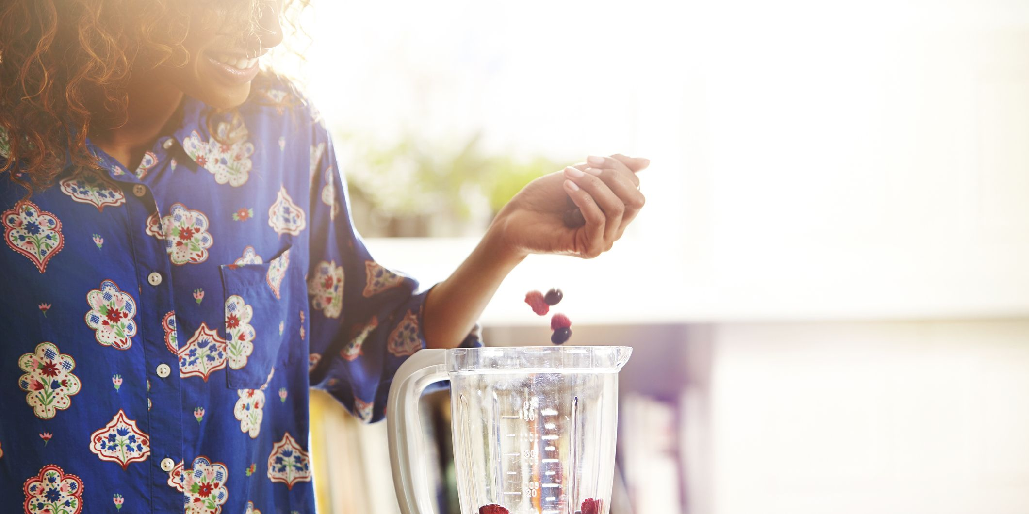 Woman making a smoothie at home.