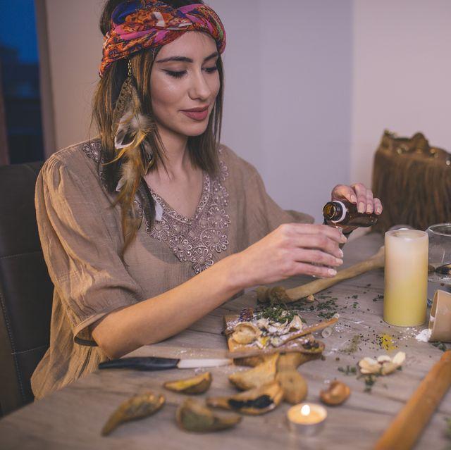 woman making natural cosmetics, top view