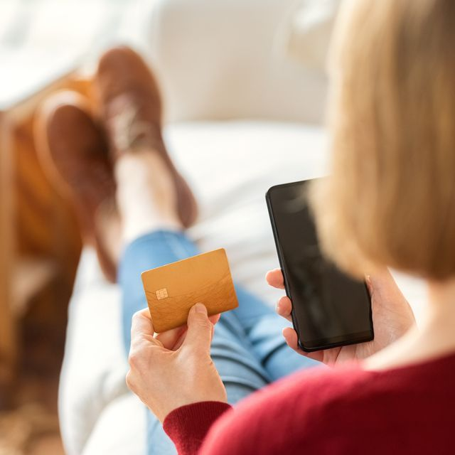 woman making online payment with mobile phone and credit card
