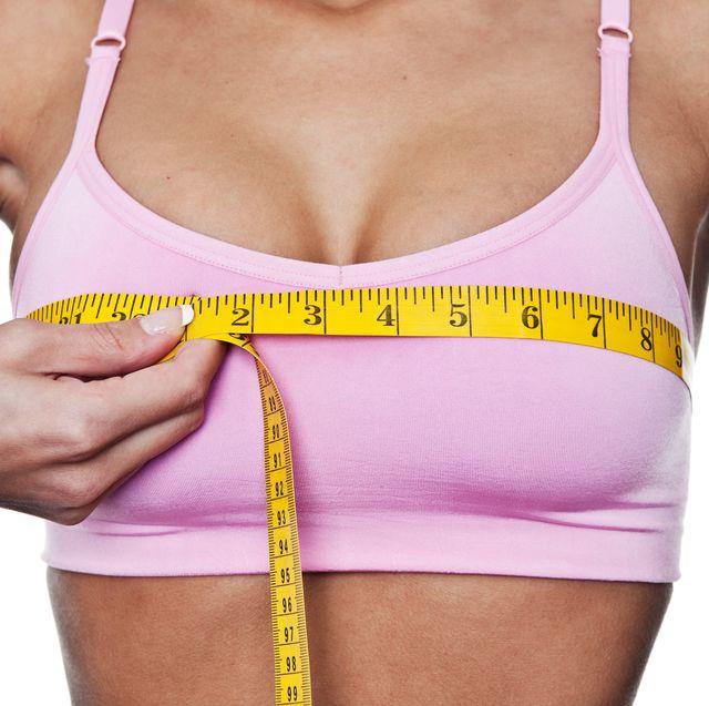 woman measuring herself