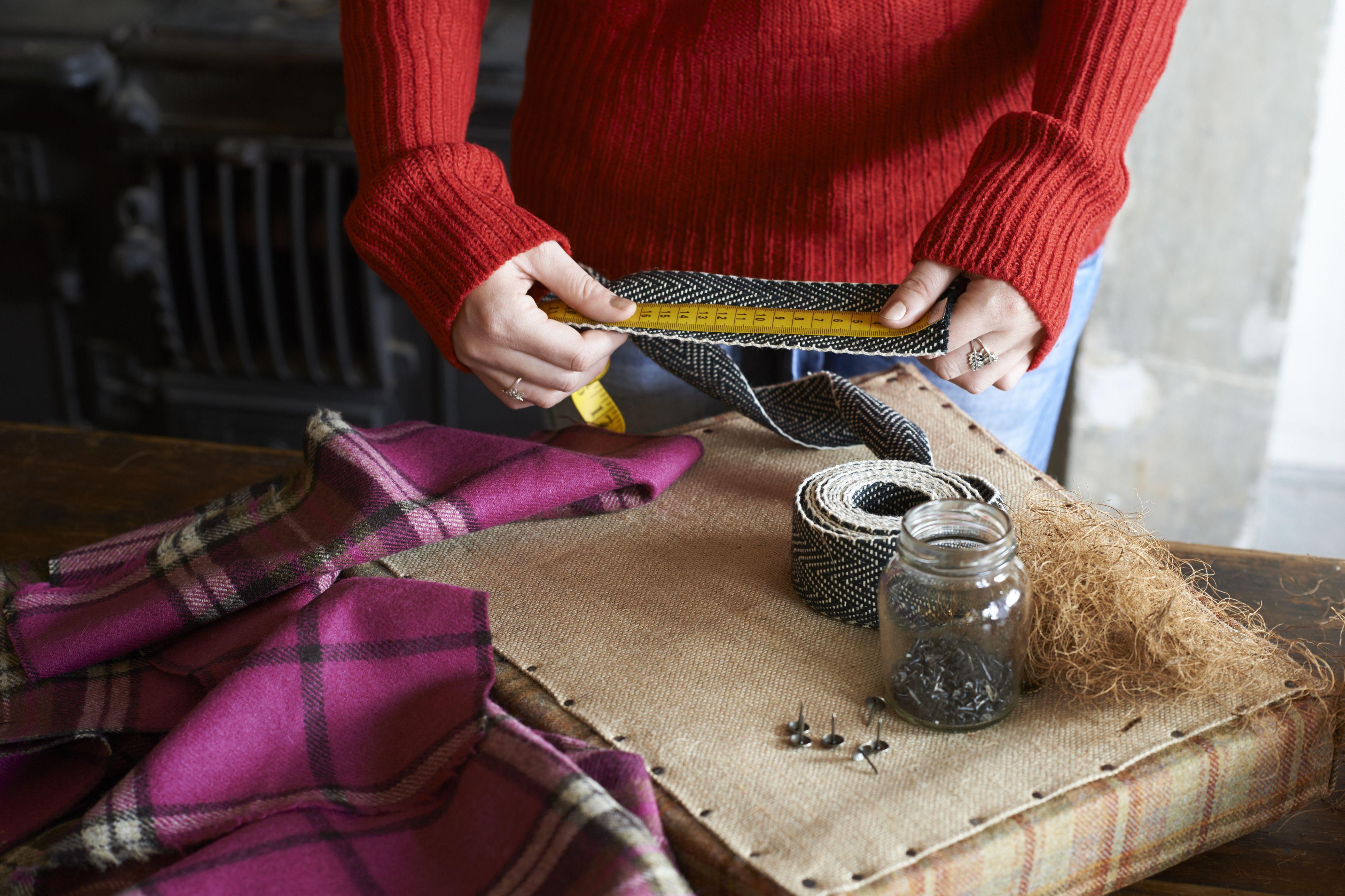 Woman measuring upholstery webbing