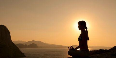 Woman Meditating in Profile