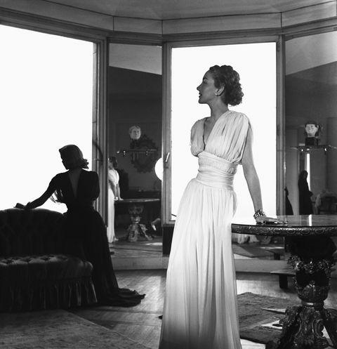 woman modeling sheer white dress
